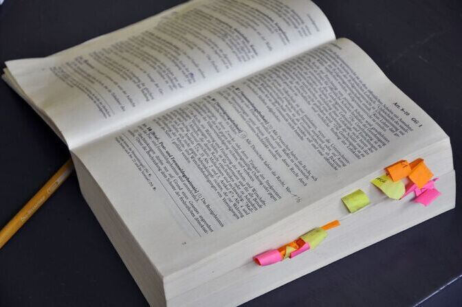 Open book with post it notes