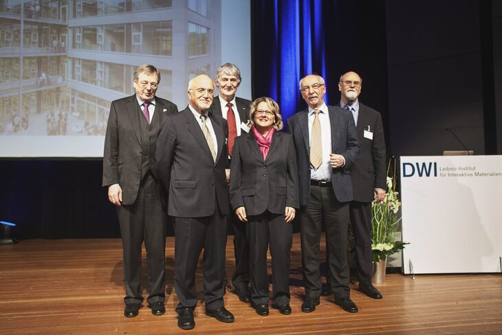 Representatives from the NRW Ministry of Science and Research, the Leibniz Association, DWI, and RWTH Aachen